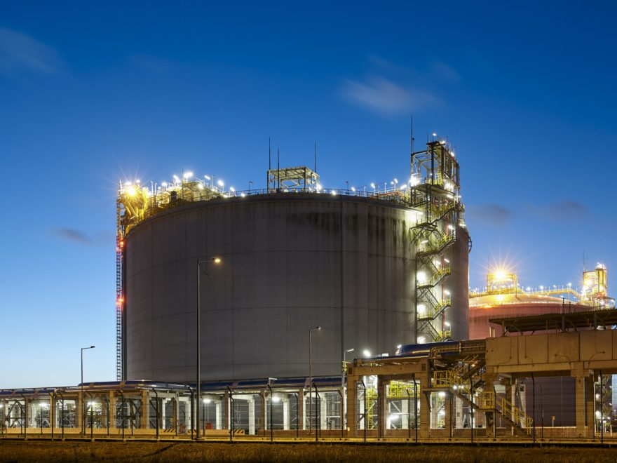 Liquefied natural gas storage tank at dusk.