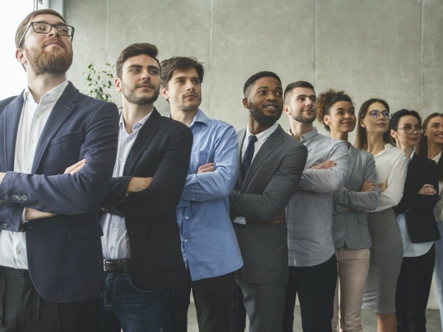 Successful business team standing in row headed with boss